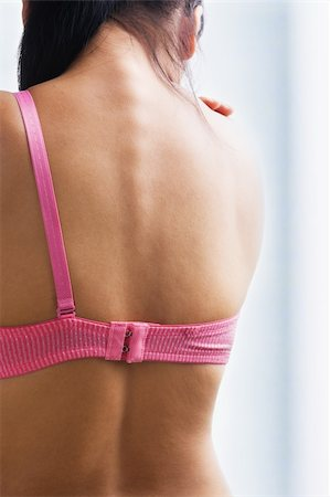 Woman back with only one bra strap for breast cancer concept Stock Photo - Budget Royalty-Free & Subscription, Code: 400-04653696