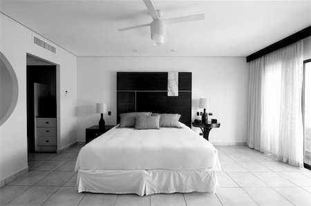 Image of a bedroom suite at a destination hotel resort. Simple and elegant. Portrayed in black and white imagery. Stock Photo - Budget Royalty-Free & Subscription, Code: 400-04664246