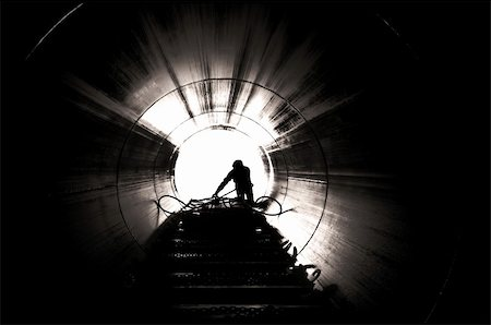 Image from inside tube looking out at a worker Stock Photo - Budget Royalty-Free & Subscription, Code: 400-04664762