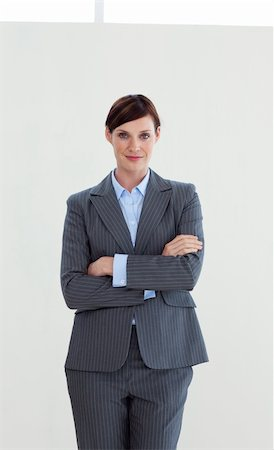 Attractive businesswoman with folded arms isolated on white background Stock Photo - Budget Royalty-Free & Subscription, Code: 400-04660445
