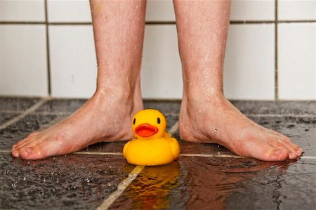 Feet of boy in shower with a lonely rubber duck Stock Photo - Budget Royalty-Free & Subscription, Code: 400-04661405