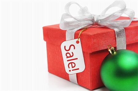 silver box - Red Christmas gift with tag and green ornament Stock Photo - Budget Royalty-Free & Subscription, Code: 400-04661679