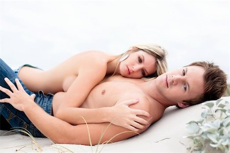 Goodlooking young couple lying down topless on the beach. Stock Photo - Budget Royalty-Free & Subscription, Code: 400-04675615