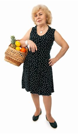 happy elderly woman with basket of fruits isolated on white background Stock Photo - Budget Royalty-Free & Subscription, Code: 400-04676008