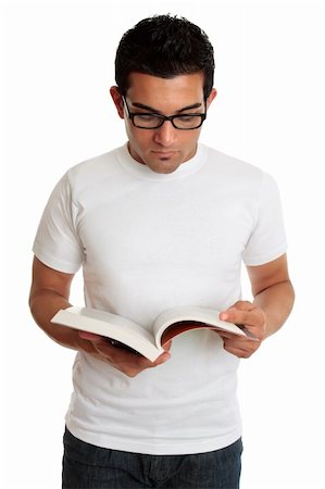 A university college student or casual man reading or studying a textbook. Stock Photo - Budget Royalty-Free & Subscription, Code: 400-04679030