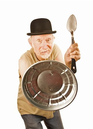 Senior in bowler hat defending himself with spoon and can lid Stock Photo - Budget Royalty-Free & Subscription, Code: 400-04670524
