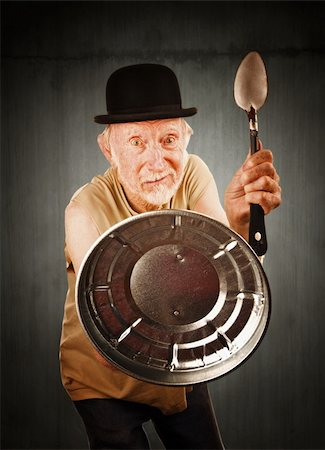 Senior in bowler hat defending himself with spoon and can lid Stock Photo - Budget Royalty-Free & Subscription, Code: 400-04670525