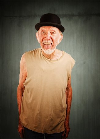 Crazy senior man in bowler hat sticking out his tongue Stock Photo - Budget Royalty-Free & Subscription, Code: 400-04670523