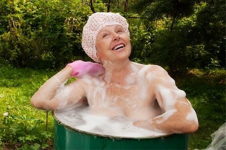 The elderly woman washes in the cask Stock Photo - Budget Royalty-Free & Subscription, Code: 400-04672288