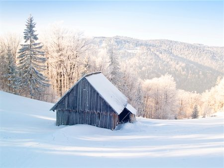 Abandoned wooden cottage in mountain under snow. Winter time. Stock Photo - Budget Royalty-Free & Subscription, Code: 400-04672774