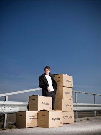 Man with Moving Boxes outdoor Stock Photo - Budget Royalty-Free & Subscription, Code: 400-04684560