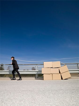 Man with Moving Boxes Outdoor Stock Photo - Budget Royalty-Free & Subscription, Code: 400-04684562