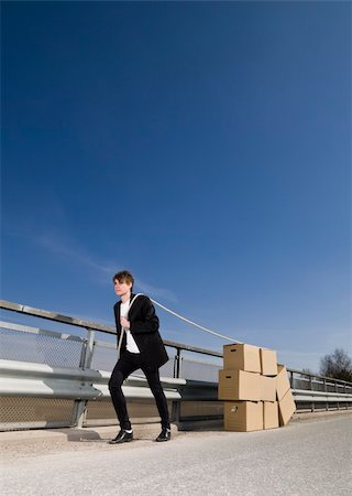 Man with Moving Boxes Outdoor Stock Photo - Budget Royalty-Free & Subscription, Code: 400-04684563