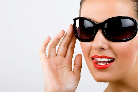 picture of an excited young woman with black sunglasses Stock Photo - Budget Royalty-Free & Subscription, Code: 400-04688299