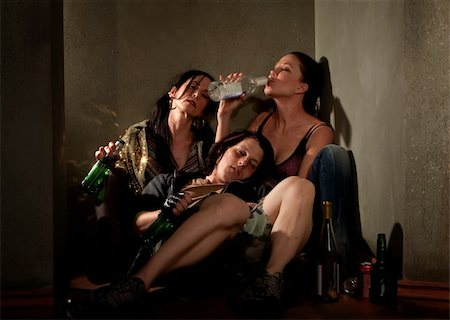 Partygoers surrounded by booze bottles in a hallway Stock Photo - Budget Royalty-Free & Subscription, Code: 400-04681328