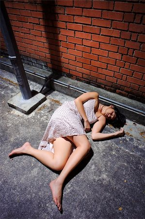 dead female body - Asian girl lies in an empty street Stock Photo - Budget Royalty-Free & Subscription, Code: 400-04682665