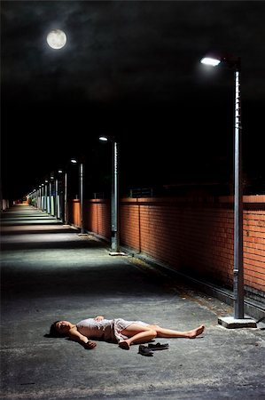 Asian girl lies in an empty street Stock Photo - Budget Royalty-Free & Subscription, Code: 400-04682666