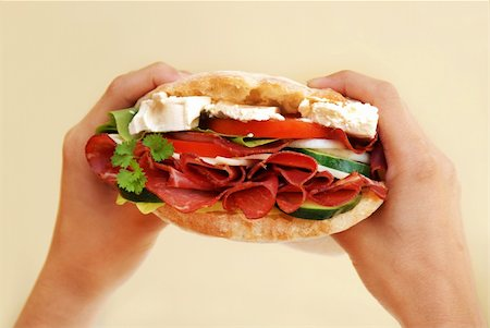 appetizing big fresh sandwich with ham, cheese and vegetables in hands Stock Photo - Budget Royalty-Free & Subscription, Code: 400-04696265