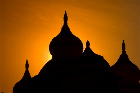 Minarets of a mosque silhouetted against an orange sunset Stock Photo - Budget Royalty-Free & Subscription, Code: 400-04700754