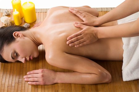 cute woman laying down on wood carpet with candle near getting an oil massage Stock Photo - Budget Royalty-Free & Subscription, Code: 400-04701185