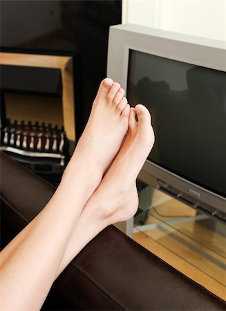 stocking feet - Close-up of woman's foot in a living-room at home Stock Photo - Budget Royalty-Free & Subscription, Code: 400-04702082