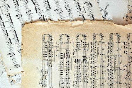 Old music sheet pages - art background. Ancient note sheets Stock Photo - Budget Royalty-Free & Subscription, Code: 400-04717160