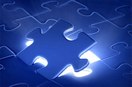 puzzle piece coming down into it's place Stock Photo - Budget Royalty-Free & Subscription, Code: 400-04717920