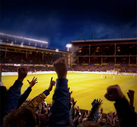 Fans excited at a football game, selective focus on fans with hands raised Stock Photo - Budget Royalty-Free & Subscription, Code: 400-04717960