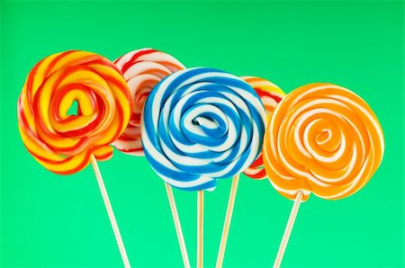 red circle lollipop - Colourful lollipop against the colourful background Stock Photo - Budget Royalty-Free & Subscription, Code: 400-04718622