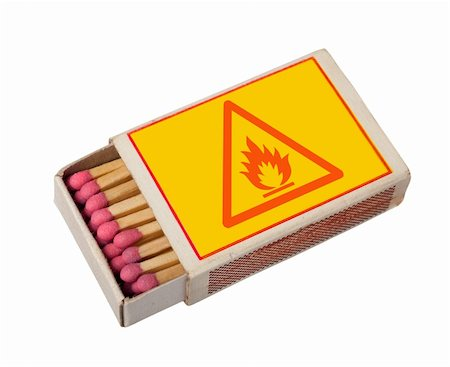 Yellow  matchbox with hazard sign isolated on white, clipping path. Stock Photo - Budget Royalty-Free & Subscription, Code: 400-04724211