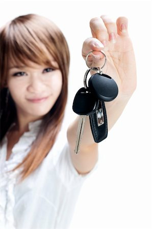 finger holding a key - Young woman holding her first own car key on white background, focus on car key. Stock Photo - Budget Royalty-Free & Subscription, Code: 400-04727026