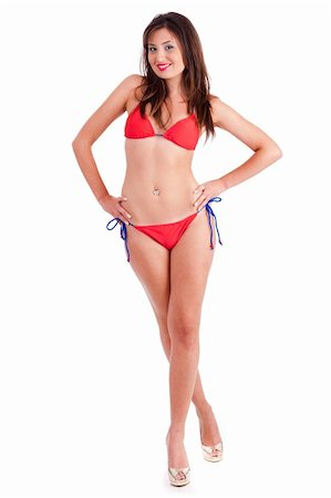 Casual pose of sexy young woman in red bikini against white background Stock Photo - Budget Royalty-Free & Subscription, Code: 400-04722736