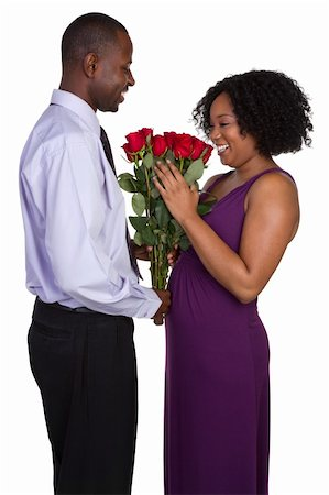 dozen roses - Romantic black couple holding roses Stock Photo - Budget Royalty-Free & Subscription, Code: 400-04739794