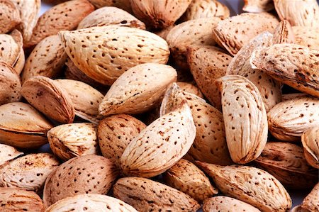 fat man balls - Almonds on white background Stock Photo - Budget Royalty-Free & Subscription, Code: 400-04730279