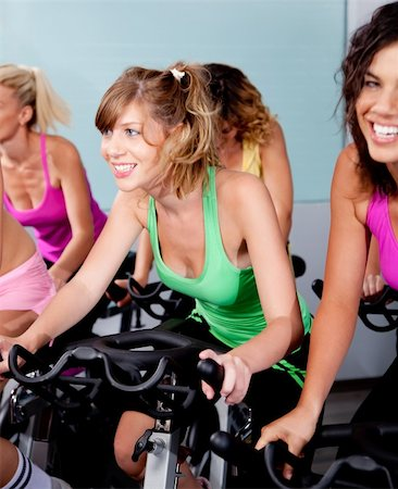 image of female cycling in fitness club Stock Photo - Budget Royalty-Free & Subscription, Code: 400-04731551
