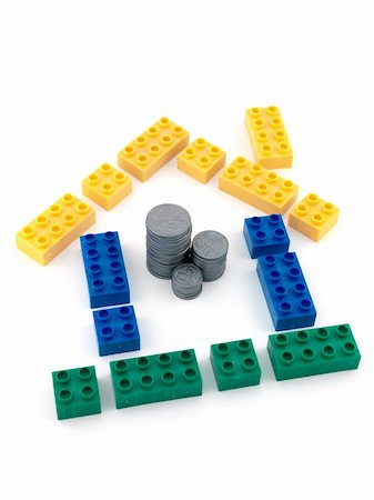education loan - A house made from blocks with a stack of play money in the middle Stock Photo - Budget Royalty-Free & Subscription, Code: 400-04744864