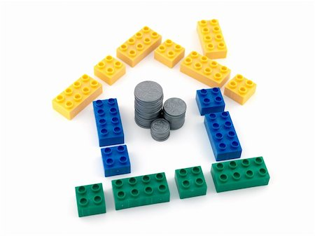 education loan - A house made from blocks with a stack of play money in the middle Stock Photo - Budget Royalty-Free & Subscription, Code: 400-04744865