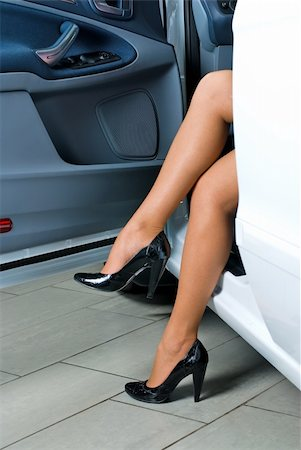 stocking feet - Young lady get out of the car Stock Photo - Budget Royalty-Free & Subscription, Code: 400-04746398