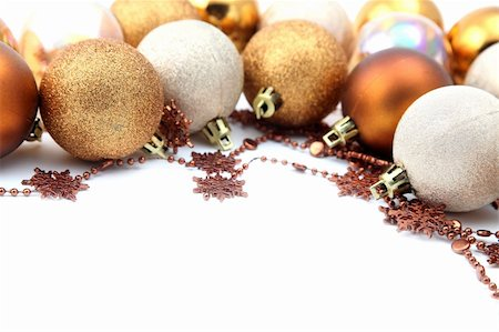 Christmas border with gold and brown ornaments isolated on white background. Shallow dof Stock Photo - Budget Royalty-Free & Subscription, Code: 400-04749446