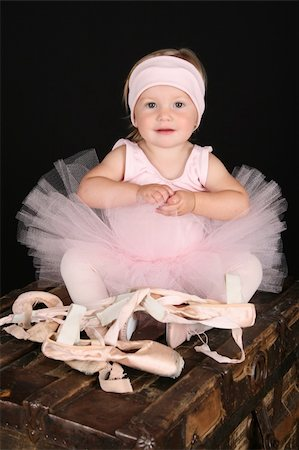 Baby ballerina sitting on an antique trunk Stock Photo - Budget Royalty-Free & Subscription, Code: 400-04740756