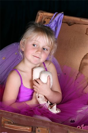 Beautiful little blond girl wearing a purple tutu Stock Photo - Budget Royalty-Free & Subscription, Code: 400-04741012