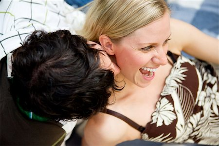A man kissing a woman on the neck and a woman smiling Stock Photo - Budget Royalty-Free & Subscription, Code: 400-04741890