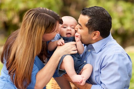daughter kissing mother - Happy Mixed Race Parents Playing with Their Giggling Son. Stock Photo - Budget Royalty-Free & Subscription, Code: 400-04743689