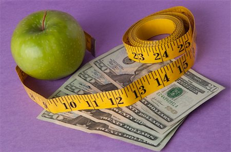 education loan - An apple, tape measure, and American currency represents the concept of measuring the cost of healthcare, food, or education.  Can also work for concept of the cost of healthcare, education or food. Stock Photo - Budget Royalty-Free & Subscription, Code: 400-04758617