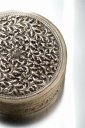 silver box - Floral patterned antique metal case on white background Stock Photo - Budget Royalty-Free & Subscription, Code: 400-04759651