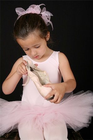Cute little brunette girl in a pink ballet costume Stock Photo - Budget Royalty-Free & Subscription, Code: 400-04750135