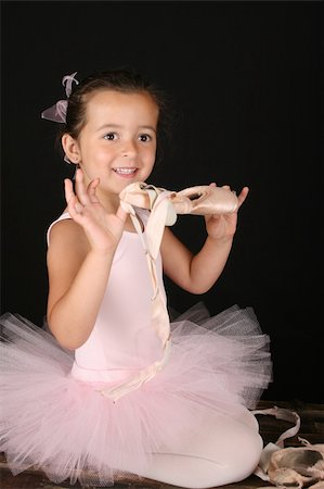 Cute little brunette girl in a pink ballet costume Stock Photo - Budget Royalty-Free & Subscription, Code: 400-04750136
