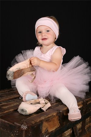 Blond toddler wearing a tutu holding pointe shoes Stock Photo - Budget Royalty-Free & Subscription, Code: 400-04751249