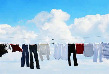Pants and shirts on clothesline against beautiful white puffy cloud on a sunny day. Stock Photo - Budget Royalty-Free & Subscription, Code: 400-04753663
