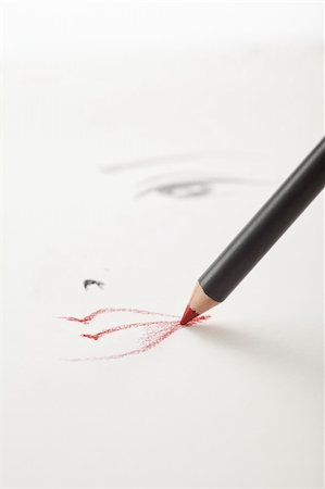 a make-up sketch, drawn on white paper, with a red lip pencil drawing the lips and one eye in the backgrownd Stock Photo - Budget Royalty-Free & Subscription, Code: 400-04766372
